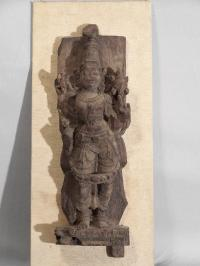 Asian hand carved architectural figure