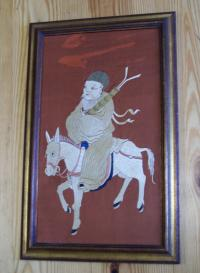 Chinese silk embroidery of a man on a horse