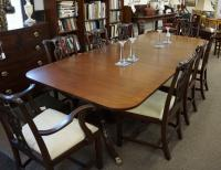 Vintage Baker furniture mahogany dining room table with three leaves