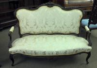 Finely carved mahogany upholstered settee c1890