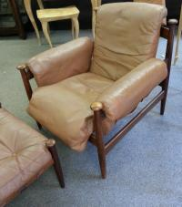 Vintage Mid Century Modern rosewood arm chair and ottoman