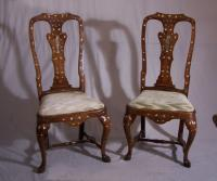 Pair Dutch Rococo marquetry chairs with figural splats c1700