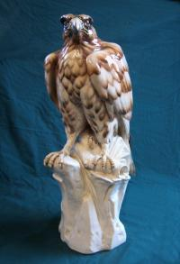 Large Continental porcelain figure of a falcon on a perch