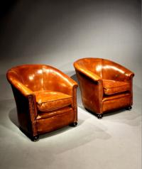 Vintage pair of Art Deco leather tub chairs c1920