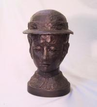 V Comley bronze head of a young woman with hat