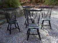Set of four vintage brace back Windsor chairs by Peter A Blekis