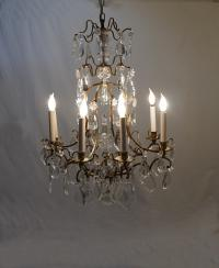 Vintage brass and crystal eight light cage chandelier