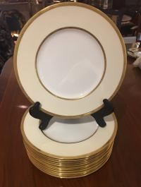 12 Minton white porcelain dinner plates with gold rims