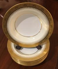 Eight Minton porcelain soup plates